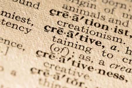 pronounce: The word creative. Close-up of the word creative in a dictionary. Stock Photo