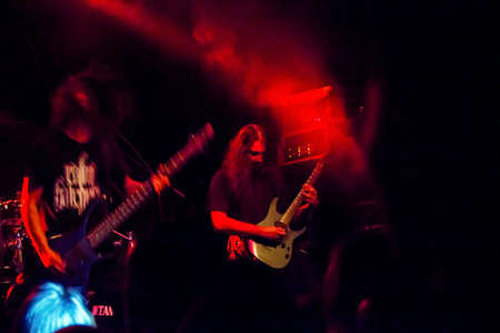 Krakow, Poland - September 20, 2014: Two artists playing guitar in a rock band music concert performance. Stock Photo