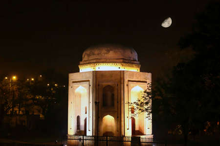 A close up shot of tomb in new delhi at night before moon - India