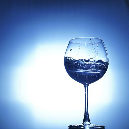 aqua water champagne glass on white blue background