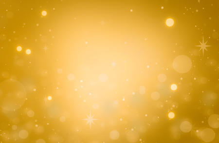Christmas glowing Golden Background. Christmas lights. Gold Holiday New year Abstract Glitter Defocused Background With Blinking Stars and sparks. Blurred Bokeh. Stock fotó