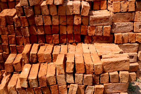 Stack of red bricks for construction purpose