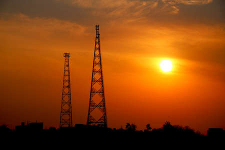 sunset view with two telecommunication tower