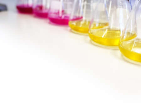 Muang, Phitsanulok / Thailand - July 19, 2019: The Erlenmeyer Flask on bench laboratory, with pink and yellow solvent solution from titration experiment, acidity, alkalinity in wastewater sample.