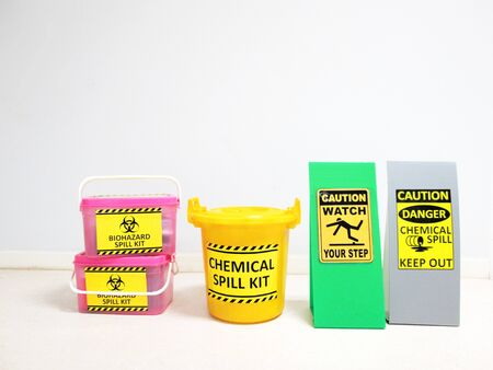 The Biohazard Spill Kit boxes with Warning danger caution Biohazard tag sign or symbol for emergency response situation when the corona virus spill out in medical room, safety first in laboratory.