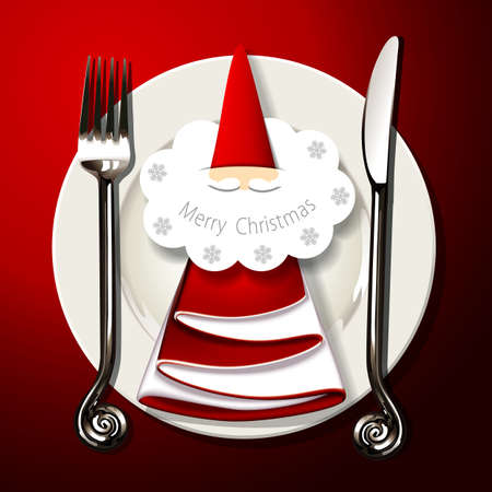 table setting with silver fork, knife and santa claus card on napkin in christmas tree shape on white plate