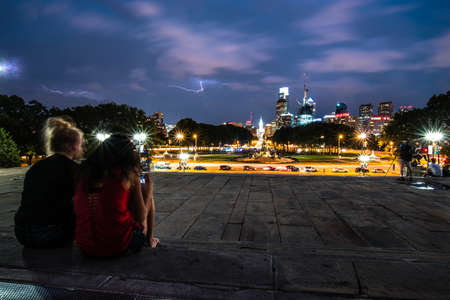 thundering: Two best friends overlooking downtown Philadelphia during a thunderstorm Editorial