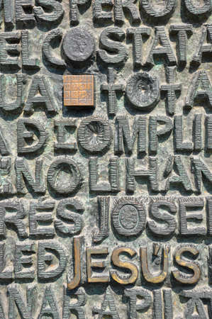 Detailed close up view on embossed religious words in stone relief found in the architectural detail by antonio gaudi