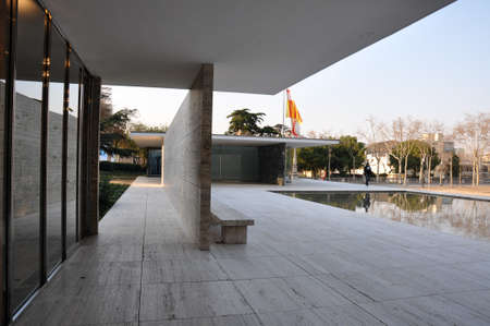 View of reflecting pool and corridor at Barcelona Pavilion by Ludwig Mies van der Rohe