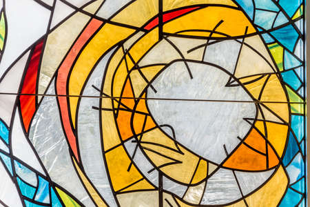 Colorful abstract design of a modern stained glass window in a close up full frame view symbolising hope, faith and God Zdjęcie Seryjne - 99401242