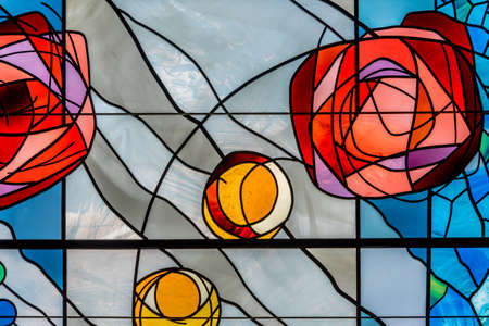 Detail of a modern colorful stained glass window in a church or chapel with abstract shapes and design Reklamní fotografie