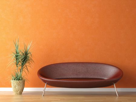 inox: red leather couch and plant on orange wall