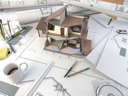 sectional: drawing table of an architect with the plans and 3d sectional model of a house
