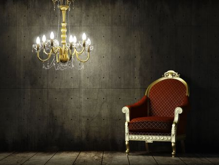 interior scene of grunge concrete room with classic golden armchair and chandelier  Stock Photo