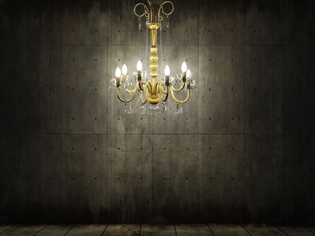 interior scene of golden chandelier in a grungy and dark concrete room photo