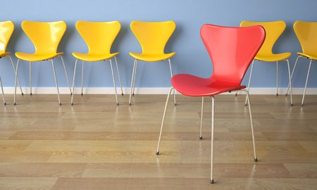 interior design row of yellow chairs against a blue wall with one red in front Stock Photo - 5117677