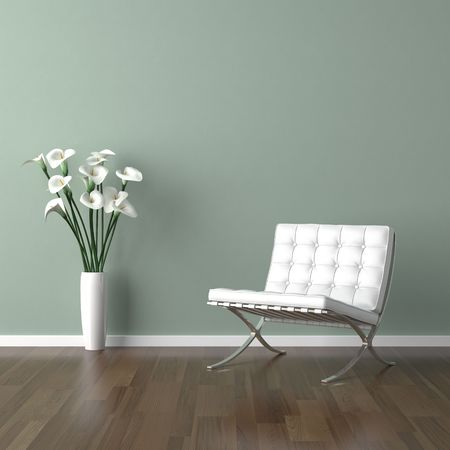 interior design scene with a white modern chair and avase of calla lillys on a pale green wall Stock Photo - 5689562