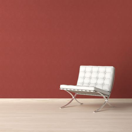 White leather chair on a red wall with copy-scape on the top left corner Stock Photo - 7150195