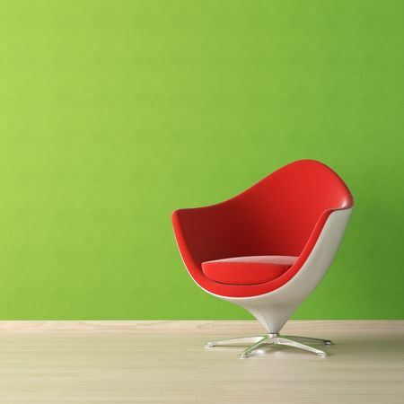 colorfully: interior design of red chair against a vibrant green wall with copy space on the top left corner