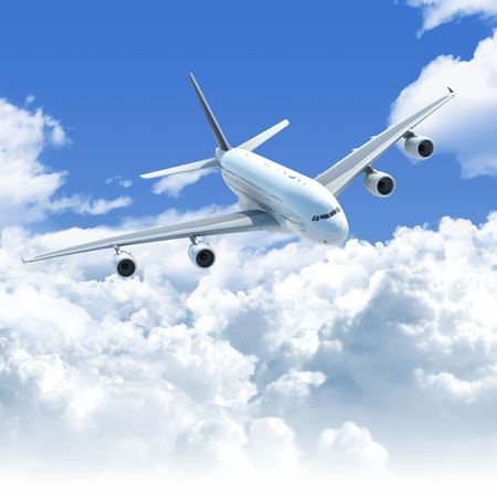 Big Jet airplane flying over a clear cloudscape seen from the top front, clipping path on the plane for easy isolation from the background photo