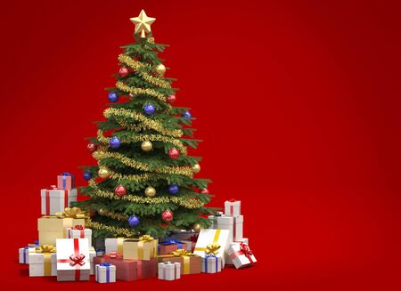 Fully decorated christmas tree with many presents isolated on red background with copy space on the right photo