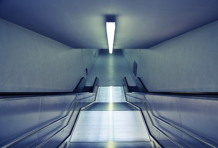downward view of modern steel subway station stairs  photo