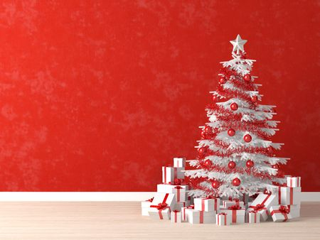 white and red christmas tree decorated with many presents on a vibrant red wall for background, copy space at left photo