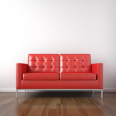 red wall: interio of red leather couch in a white room