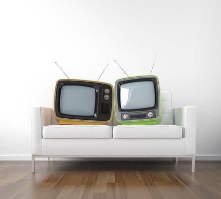 pareja viendo tv: dos tv retro en un sof� como una met�fora de pareja mirando televisi�n escena conceptual con espacio de copia