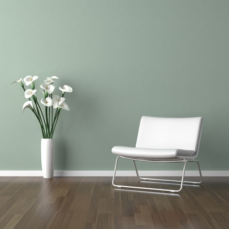 interior design scene with a white modern chair and avase of calla lillys on a pale green wall Stock Photo