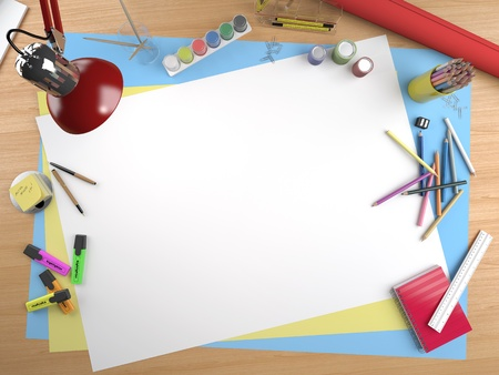 white canvas on a drawing table with lots of stationery objects making a center copy space for you text or design photo