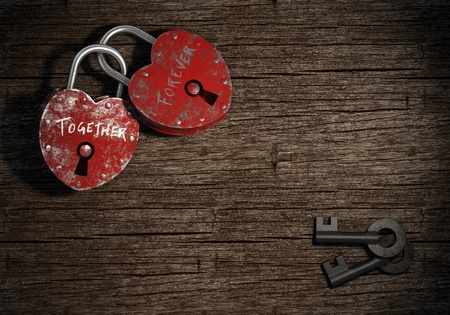 vow: two padlocks with together forever writen as concept for eternal  love on a wood background Stock Photo