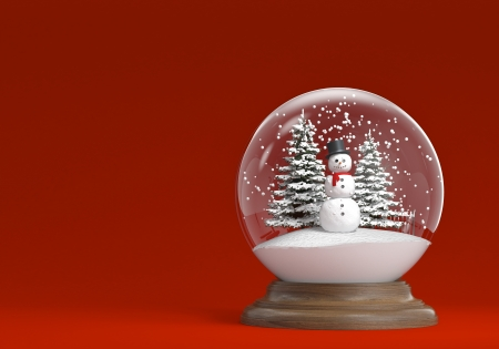 snowglobe whit snowman and trees on a red background with copy space, photo