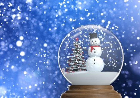 snowglobe with snowman and christmas tree inside on a blue snowy defocused background copy space Stock Photo