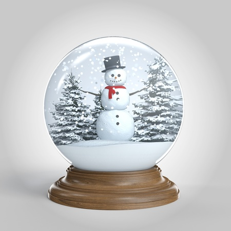 snowglobe with snowman on winter scene isoalted on white background  photo