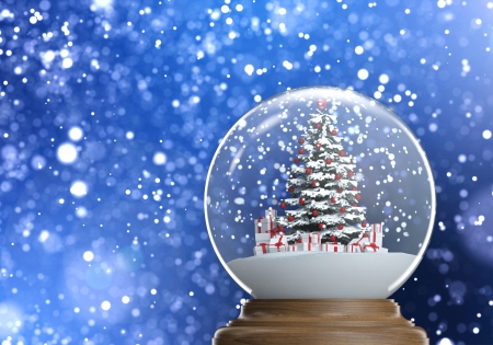 snowglobe with red decorated christmas tree and presents inside on a blue winter defocused background, photo