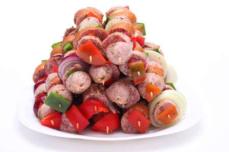 barbacoa de salchichas en un plato Foto de archivo