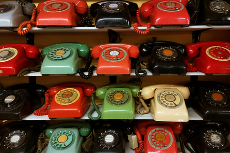 shelve: Collection of vintage rotary phone arrange on the shelve