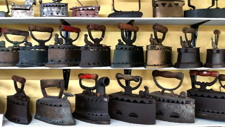 shelve: Collection of antique laundry iron arrange on the shelve Stock Photo