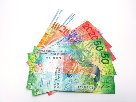 Swiss franc bank notes arrange like paper fan on  white background with cliiping path Banque d'images