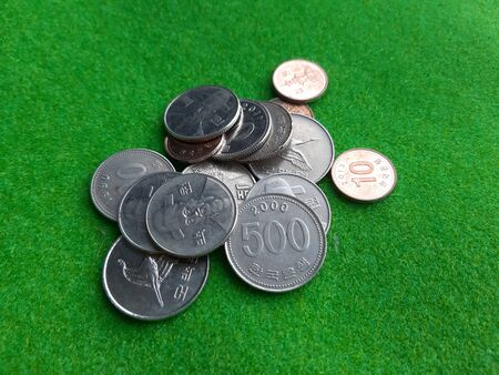 Korean currency coins stack on the green woolen fabric Stock Photo