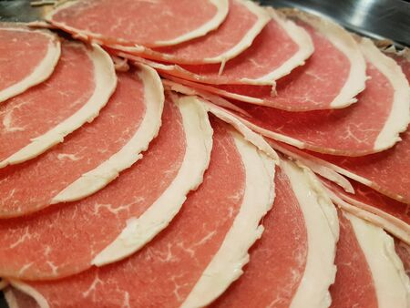 closed up sliced beef teneloin look great for shabu or grill