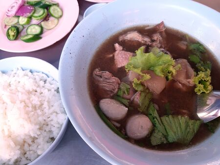 Beef stew soup with rice - Thai traditional street food usually found in beef noodle shop Stock Photo