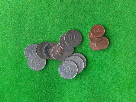 Top view of Korean coins stack on the green woolen fablic