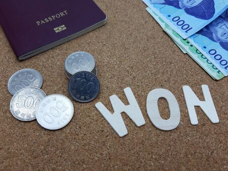 Money and passport for a trip to Korea