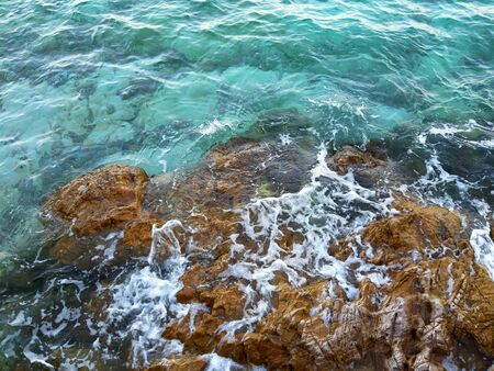 top view of rocky coast show wave foam and rock in summer Stock Photo