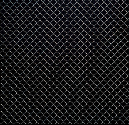 Close up on wire mesh texture on black background photo