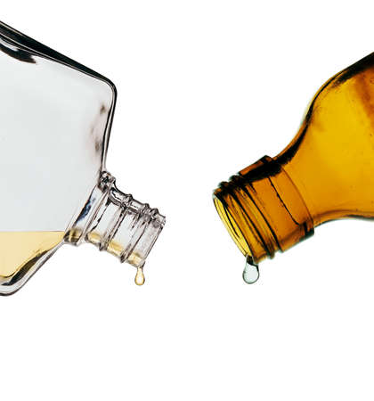 toxicology: Stil life photography of brown and clear glass lab bottles Stock Photo