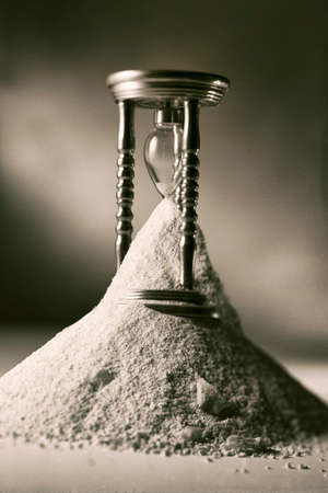 symbolically: Vintage photo of hourglass, symbolically showing the passing of time