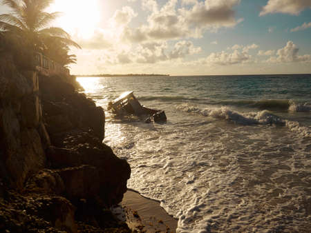 stranded: Beautiful sunrise and stranded boat in Barbados